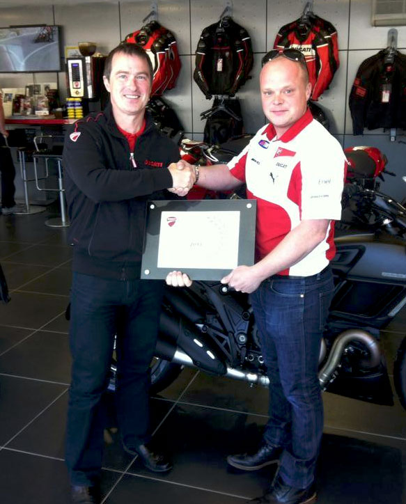 Chris Booth accepting Ducati Dealer of the Year Award